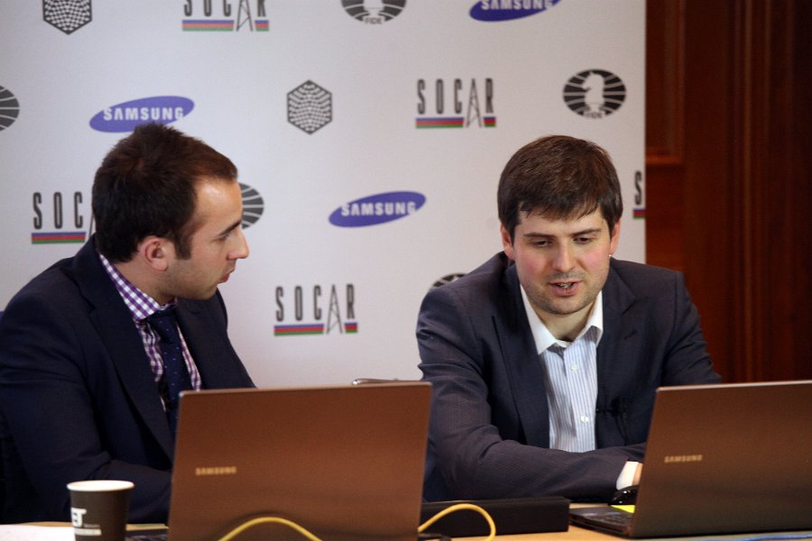 Svidler and Trent during a conference