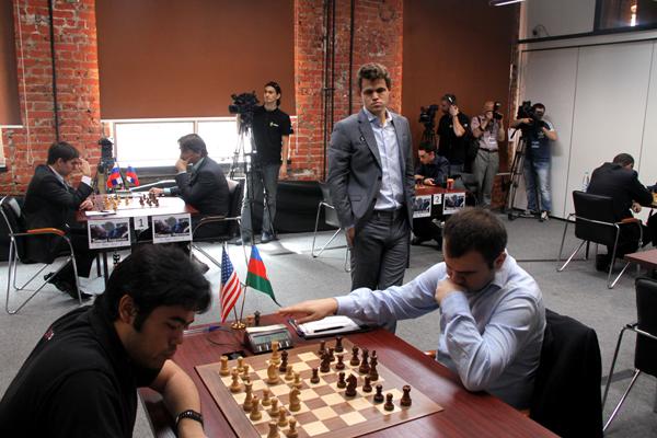 Nakamura-Mamedyarov, Carlsen watching the game