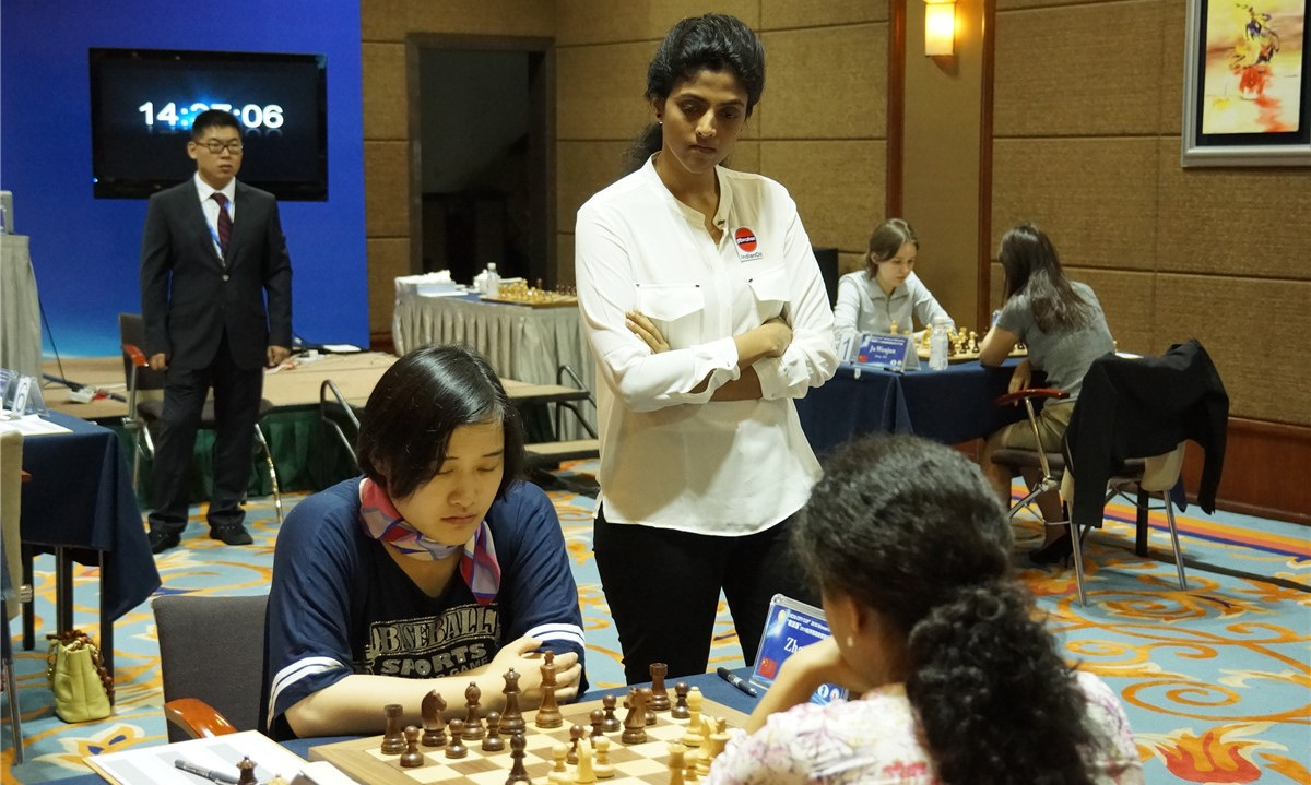 Tournament Hall (Photo taken from the official site). Harika standing, Koneru-Zhao are seated.